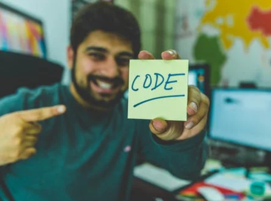 man teaching others how to code