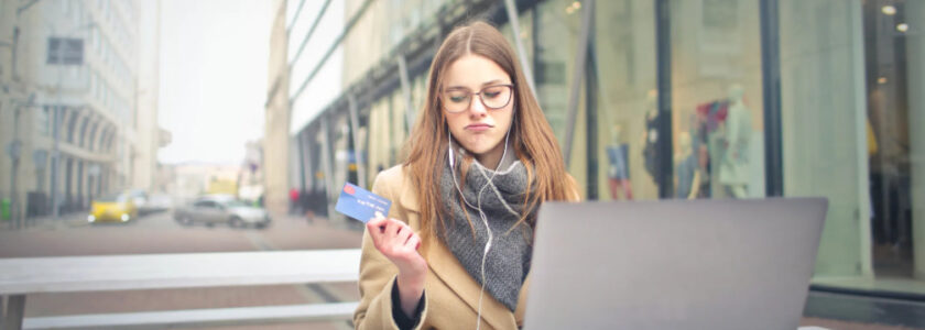 woman unsure about whether to complete a purchase online