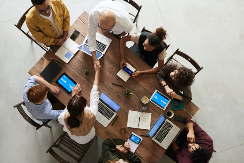 Small business team around a table for security meeting