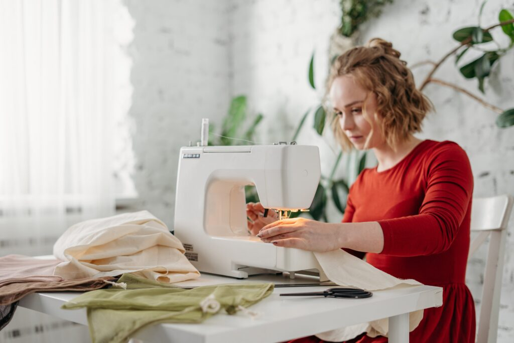 woman sewing as her side hustle